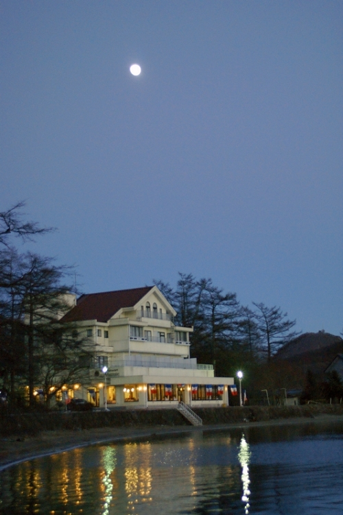 Moon over a hotel at Lake Haruna